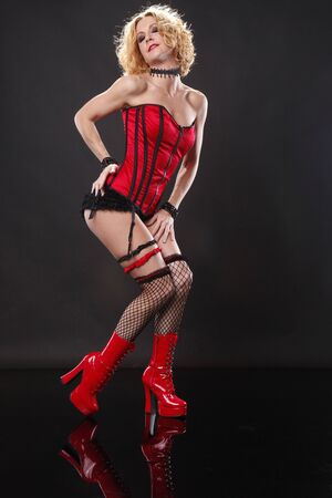 red corset: Cute blond in red corset Stock Photo