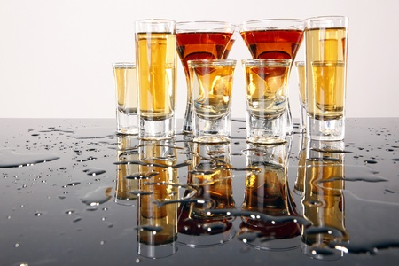 Shooters with whiskey, tequila and rum photo