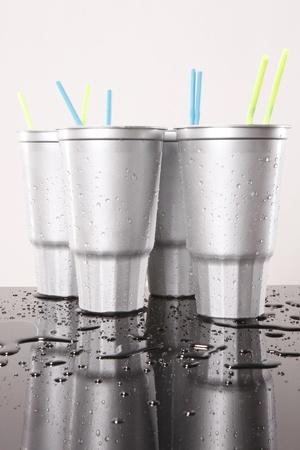 slushy: Cold silver soda plastic cups Stock Photo