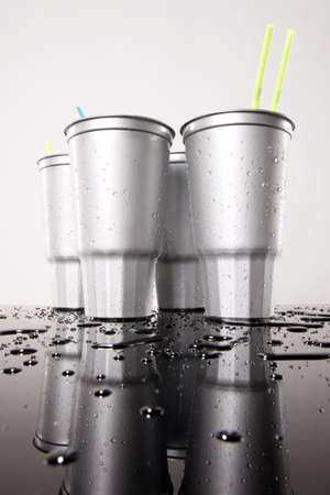 Cold silver soda plastic cups low view