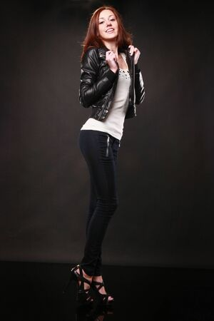 Cute redhead with leather jacket photo