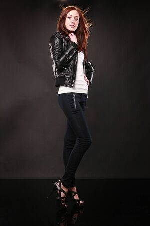 Cute redhead with leather jacket