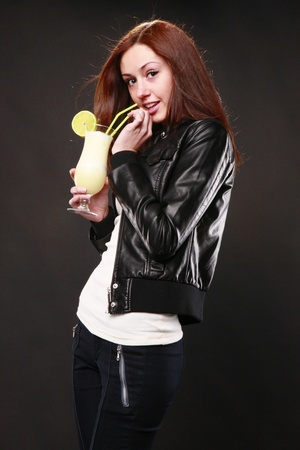 Cute redhead with leather jacket and daiquiri cocktail photo