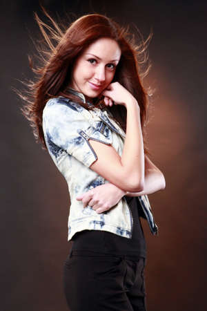 Cute redhead with jeans jacket Stock Photo - 8705982