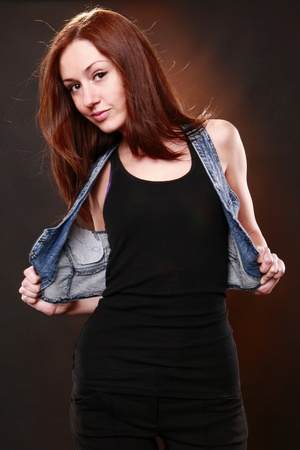 Cute redhead with jeans vest photo
