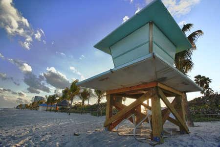 Lifeguard hut at sunset photo