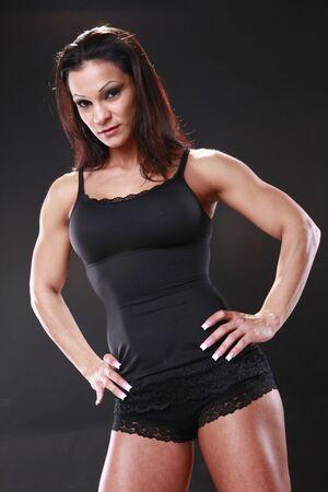 female fighter: Boby builder on black background