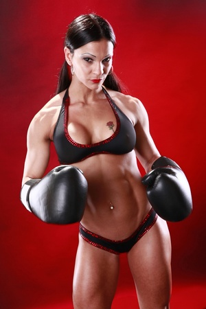 Fit female boxer swings a punch Stock Photo - 8705943