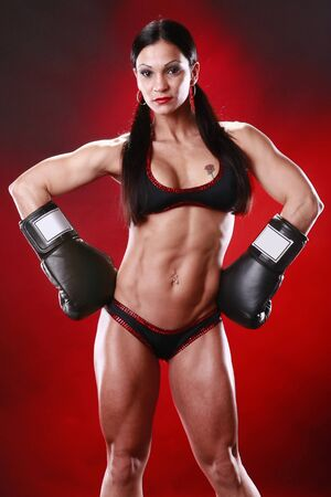 female boxer: Fit female boxer swings a punch