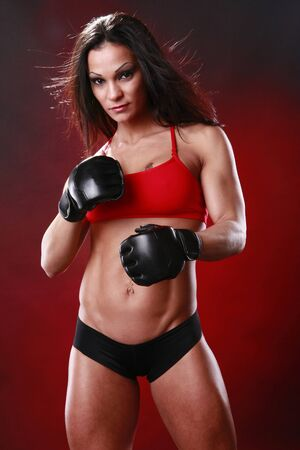 Fit female fighter gloves on photo