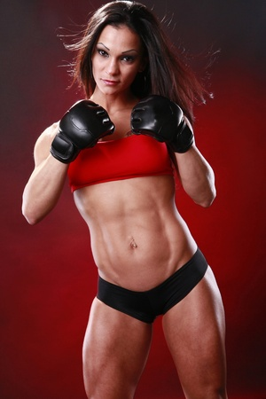 female bodybuilder: Fit female fighter gloves on