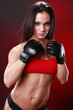 tough: Fit female fighter gloves on
