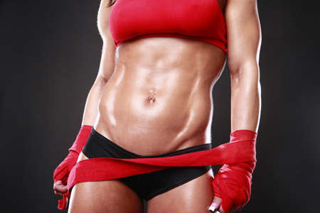 Body builder with boxing wraps photo