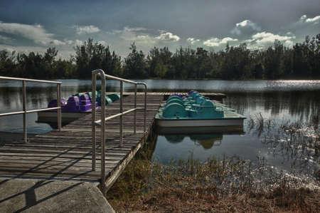 ashore: Moonlight over pedal boat dock Stock Photo