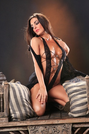Sexy brunette on a vintage asian chair