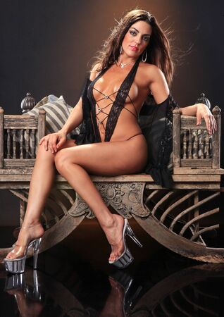 high heels woman: Sexy brunette on a vintage asian chair