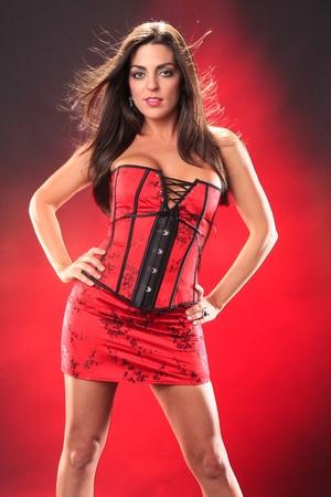 Cute brunette in cheongsam corset