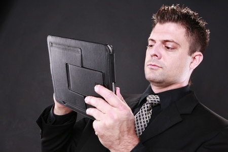 Businessman and his tablet pad photo