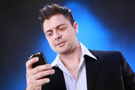 Young man and his smart phone photo
