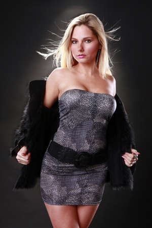 Sexy blond and her fur coat Stock Photo - 9138096