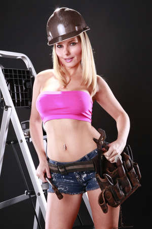 Sexy handyman gets ready to work Stock Photo - 9138094