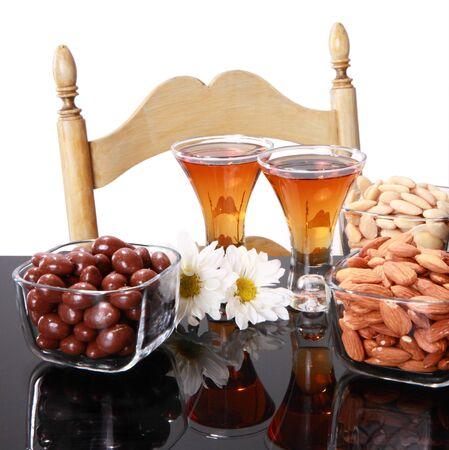 Acouple of almond liquor shots and daisies