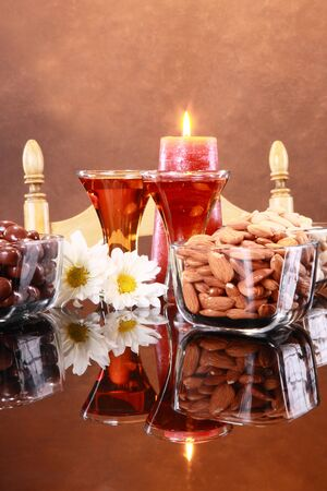 Candelight over a couple of shots and snacks photo