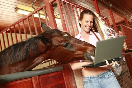Blond and her horse check their social media site