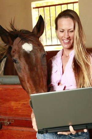Blond and her horse check their social media site photo