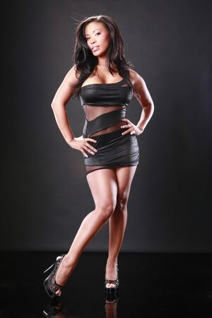 Cute African-American in a sexy little black dress Stock Photo - 9335113