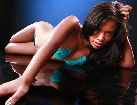 Cute black girl in blue bikini