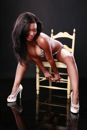 erotic girl: Sexy caribbean girl on a chair