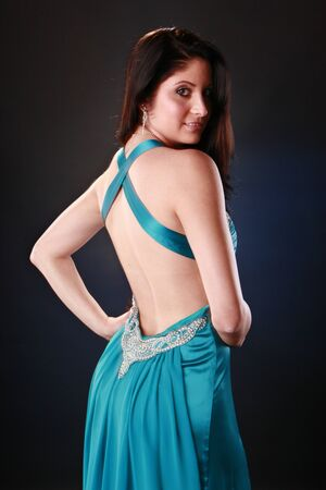 Cute brunette in cocktail gown Stock Photo - 9497490