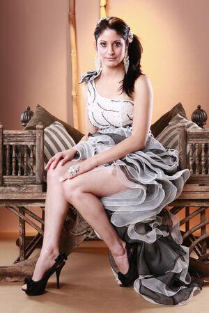 Cute brunette in flamenco dress on vintage chair Stock Photo - 9497846