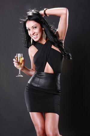 Cute brunette celebrates in evening attire photo
