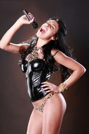 Brunette performing in funky attire Stock Photo - 9497806