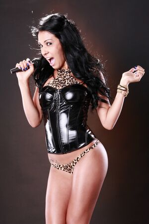 Brunette performing in funky attire photo