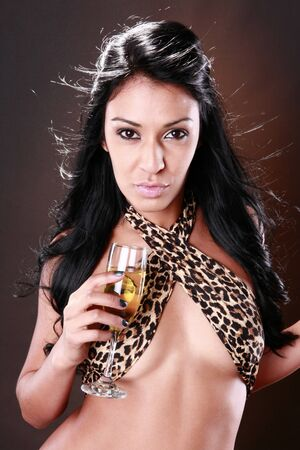 Hot brunette enjoys a glass of wine photo