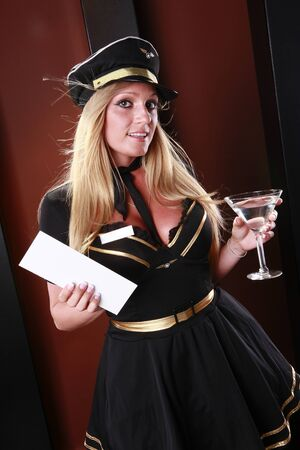 Blond stewardess has your boarding pass and a drink photo