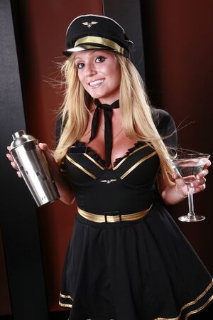 Blond stewardess with shaker and martini photo