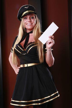 Blond stewardess has your boarding pass Stock Photo - 9685514