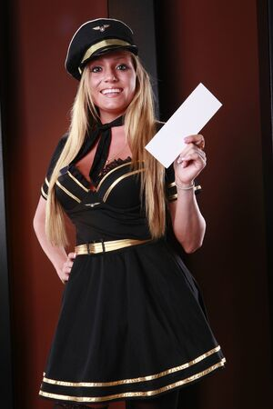 Blond stewardess has your boarding pass Stock Photo - 9685514