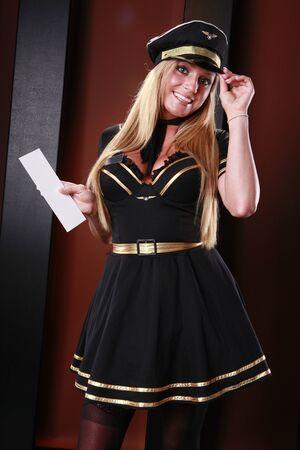 Blond stewardess has your boarding pass photo
