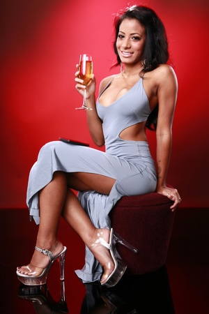 african american woman: Cute caribbean girl texting about her drink Stock Photo