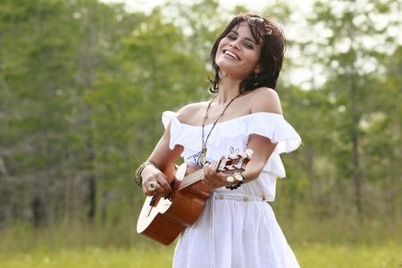 South American cuatro singer photo