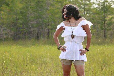 Cute brunette enjoys nature photo