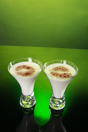 egg nog: Two glasses of holiday egg nog decorated with kiss like cinnamon topping