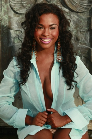 Cute African American in turquoise blouse Stockfoto