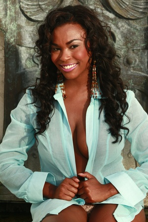 Cute African American in turquoise blouse Archivio Fotografico