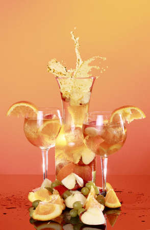 A couple of glasses of cold white Sangria and splashing carafe photo